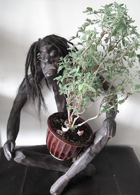 Asmat handcarved statue_with Rober's Lemon Rose