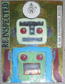 robot painting on tin
