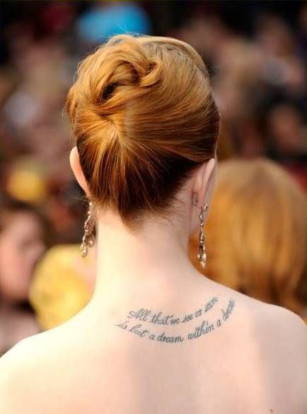 "Evan Rachel Wood's tattoo on her neck resembles a Manson lyric ""There is a"