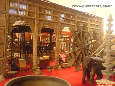 antiques shop in cochin jew street displaying antiques pieces and timber sculptures and copper alloy statues for sale and exhibition for the tourists coming to kerala
