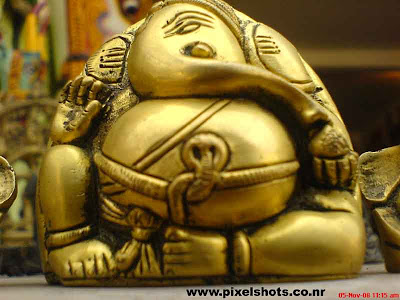 hindu god ganesh or ganapathy resembling made in copper for sale in a fancy street side shop in mattancherry cochin kerala india
