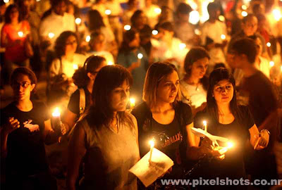 candle procession by people of mumbai india for peace after terrorists attacked mumbai on 6/11