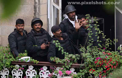 commandos in the taj palace hotel balcony just after the anti terrorist operation on terrorist attack on mumbai