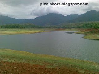 river bank and river valley photograph from the mangalam dam reservoir site in palakkad kerala