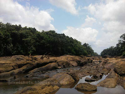 rock filled river terrain, dangerous parts of kerala rivers india, rock filled river beds seen in kerala rivers, thenmala photos river kallada kerala india, empty dry river beds