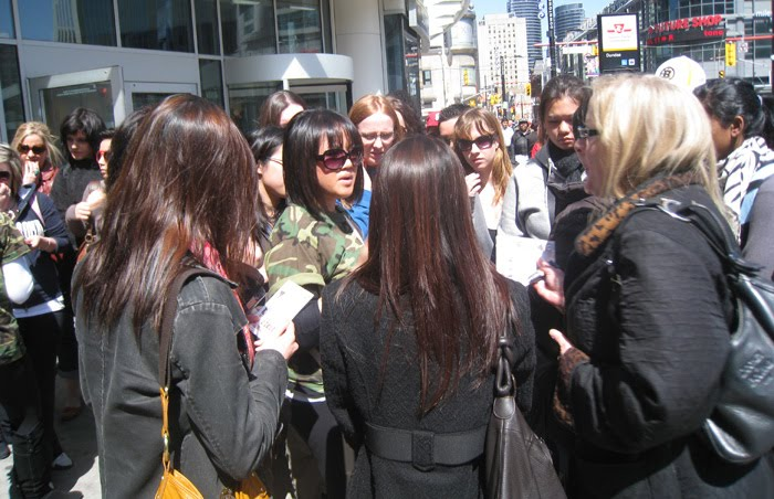 Cover FX Marketing Coordinator, Melissa, being swarmed by fans!