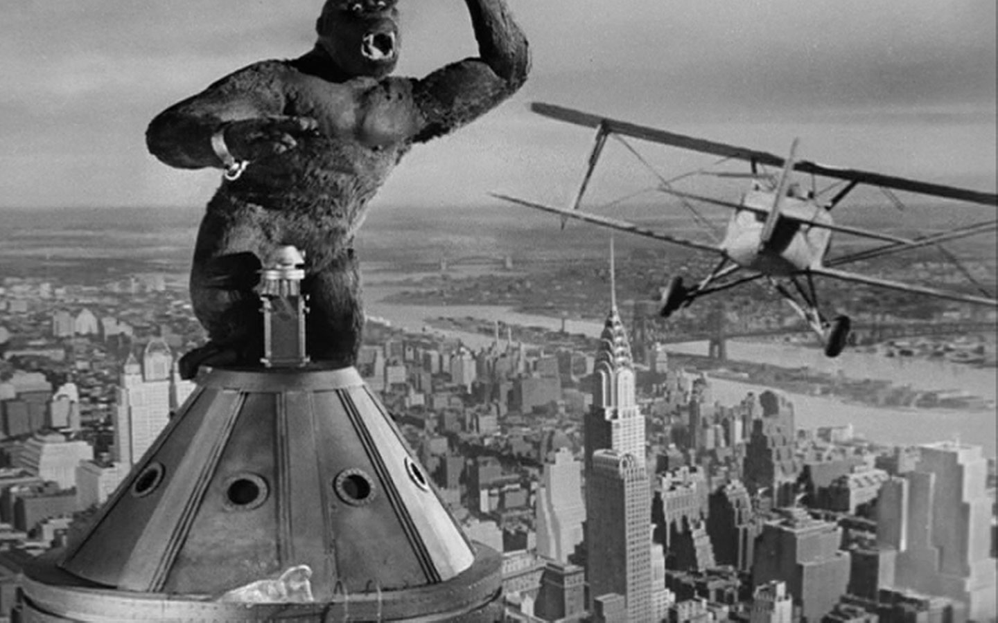 Kong takes a swipe at an attacking airplane