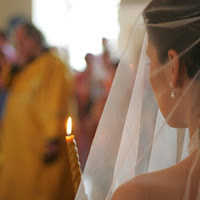 Bride walking with lit memorial candle