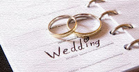 planner and wedding rings