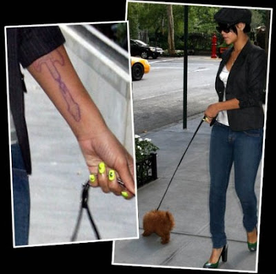 Pictures Infected Tattoos on Rihanna S Latest Gun Tattoo