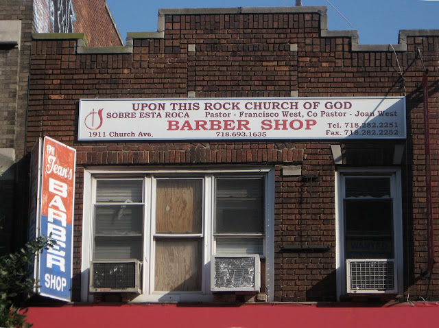 Sign of a church - barber shop combo.