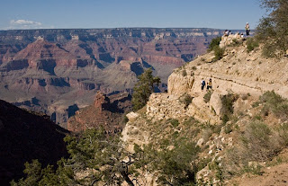 Click for Larger Image of people hiking the switchbacks at the beginning of Bright Angel Trail