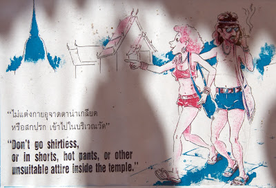 tourists don't go shirtless, in shorts, hot pants in temple in thailand