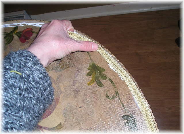 Tutorial on how to decoupage fabric onto a damaged table top