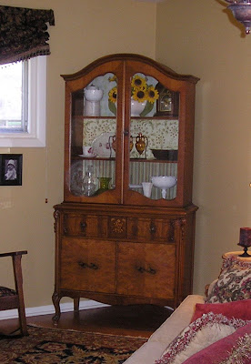 China cabinet before. Give it a makeover with paint and door removal.
