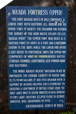 The signboard giving the history of the Aguada fort in Goa along with an explanation of the upper and lower portions of the fort
