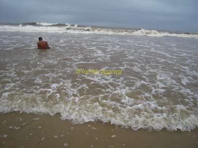 Enjoying at Baga beach, waiting for the water to inundate and cover
