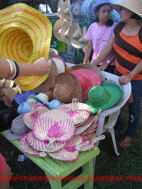 Hats and fans for sale in Pahiyas