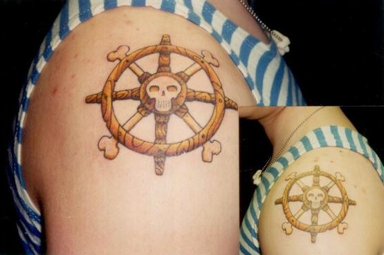 Tattoo; Color, Boat Wheels with Skull, Both Arms. Posted by Collin Kasyan
