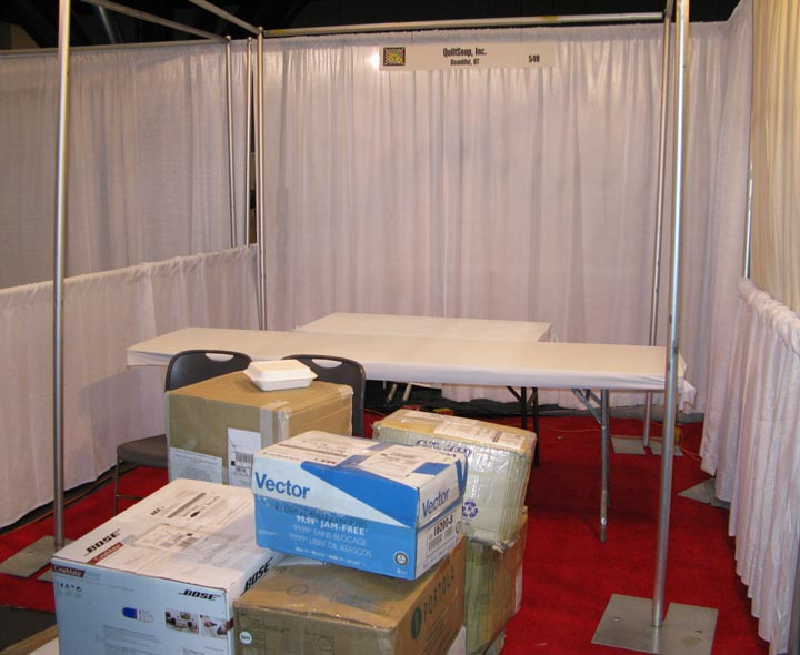 Our booth after we hang a few things. Photo is taken from aisleway in