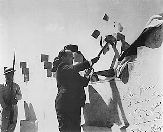 In 1948, Jose Figueres abolished the army of Costa Rica. This picture depicts Figueres in the symbolic action of destroying a portion of the military barracks. (Photo courtesy of the Arias Foundation)