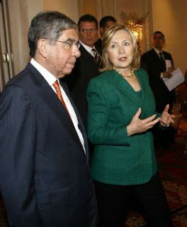 Costa Rica's President Oscar Arias (L) walks next to U.S. Secretary of State Hillary Clinton during a meeting in San Jose March 4, 2010. (Photo: REUTERS/Juan Carlos Ulate)