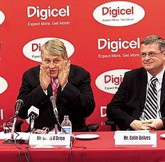 Digicel chairman Denis O'Brien, on the left, during a press conference. Listening next to him is Digicel Group CEO Colm Delves. (Photo: Andrea De Silva / The Trinidad Guardian)