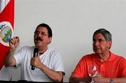Hondura's President Manuel Zelaya, left, speaks as Costa Rica's President Oscar Arias looks on during a press conference at the Juan Santamaria International airport in San Jose, Sunday, June 28, 2009. Soldiers seized Honduras' national palace and sent Zelaya into exile in Costa Rica on Sunday, hours before a disputed constitutional referendum. (AP Photo/Kent Gilbert)