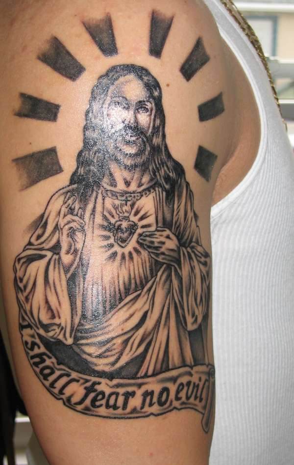 jesus face tattoo This is another nice tattoo. The thorns, beard and the