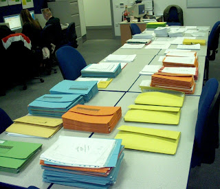 Photo: Piles and piles of coursework to be marked and assessed.