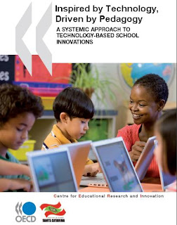 Picture of front cover of book - children and teacher working on laptops