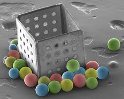 2010 Spring Meet - 2nd Place Winner - Bad Pitch - David Gracias, Johns Hokins University: SEM image of microbeads lying outside a self-assembled 500 micron sized box.
