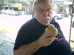 SIPPING THE JUICE OF A YOUNG COCONUT AT KARON BEACH PHUKET FEB. 2008
