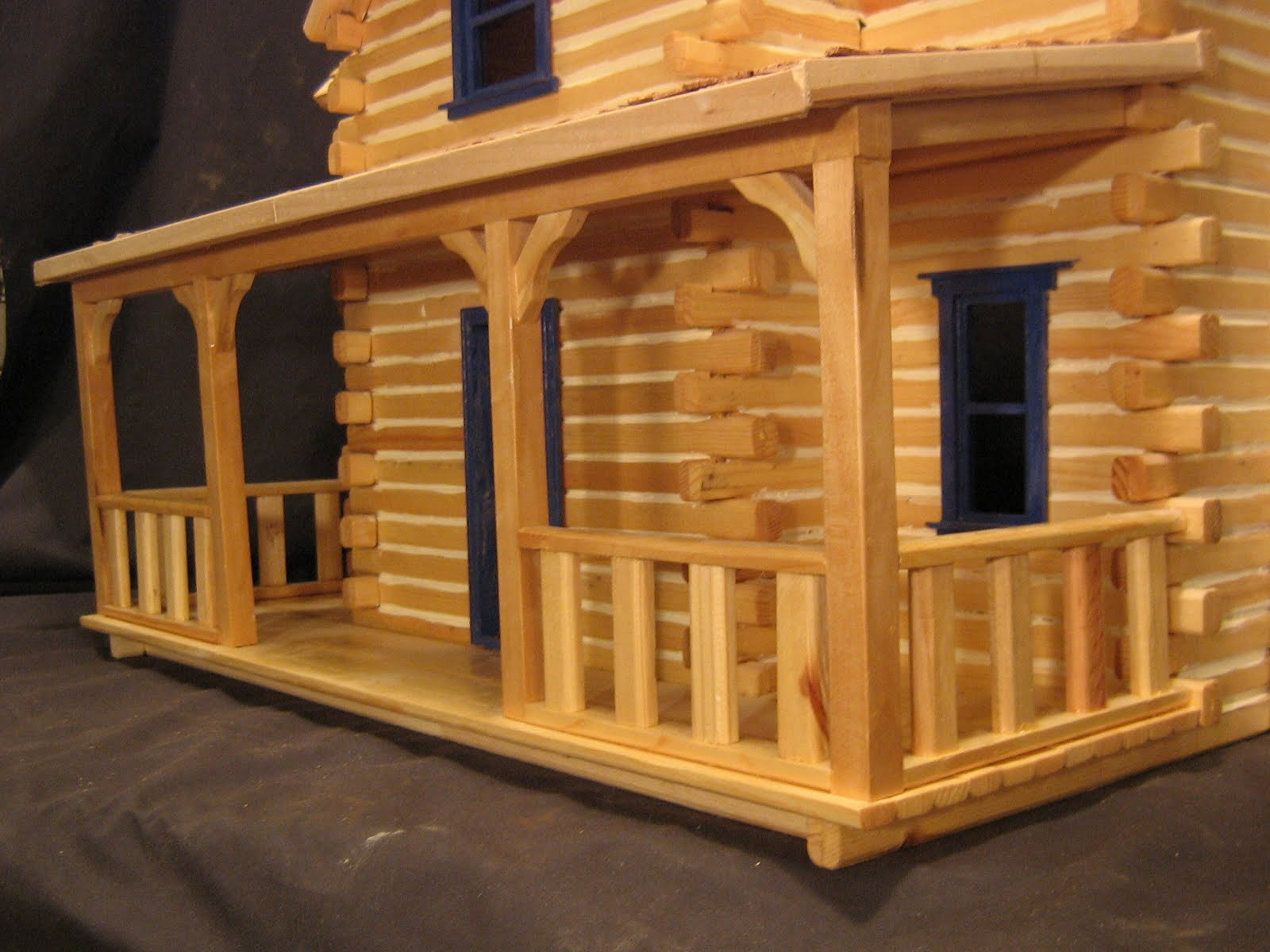 how to make a log cabin out of sticks
