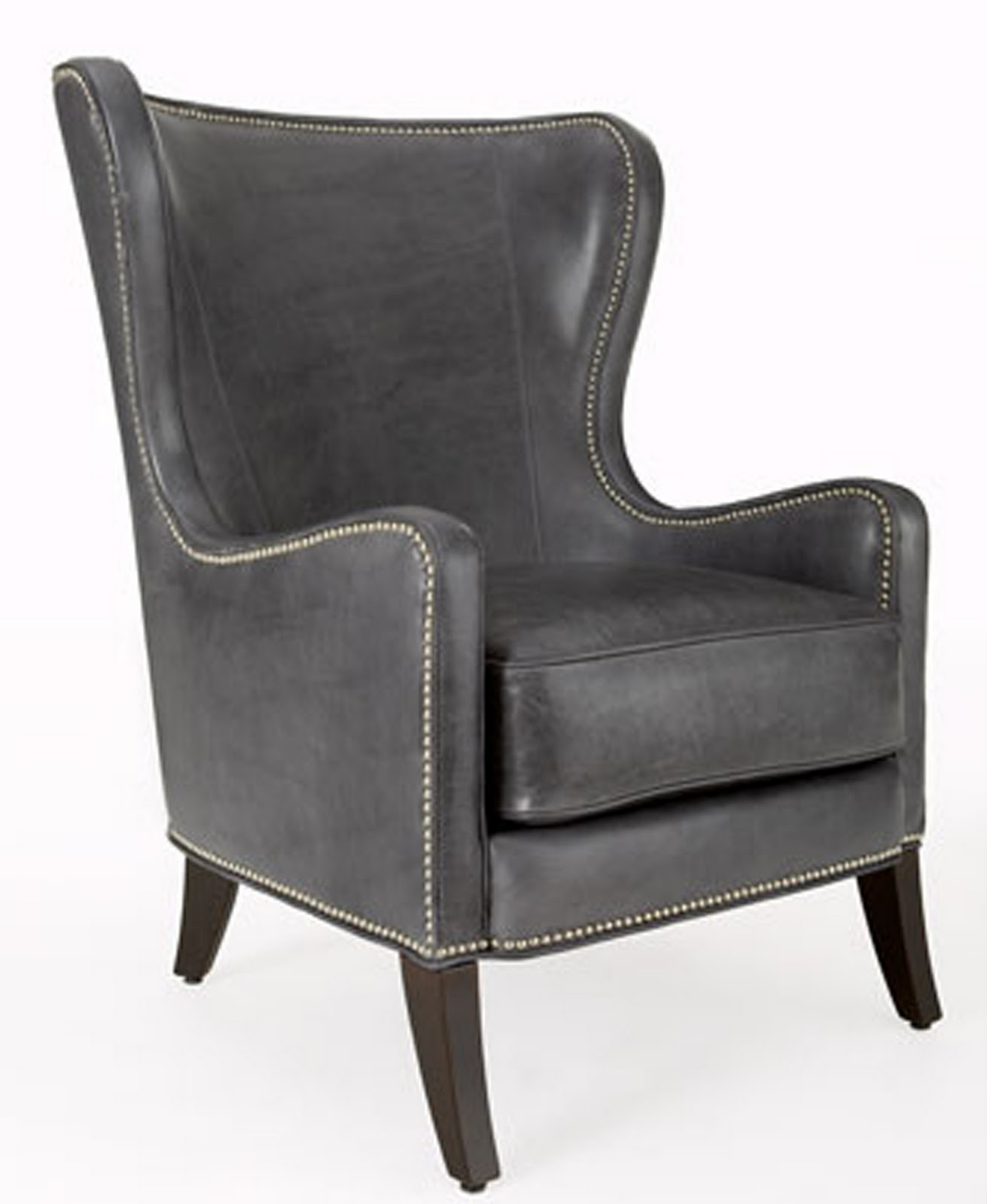 Leather chair has hardwood frame and nailhead trim