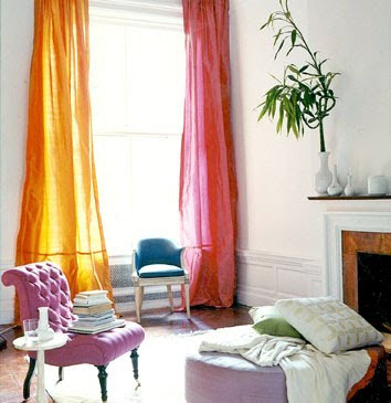 white living room with yellow and pink silk drapes lavender chair