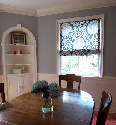 gray dining room with blue floral Roman shade