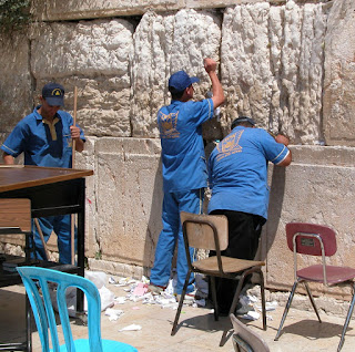 Western+Wall+men+cleaning+out+prayers,+tb090402 Scrawling, Scrabbling, and Burying Our Prayers