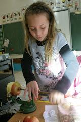 Meagan cranks the apple machine.