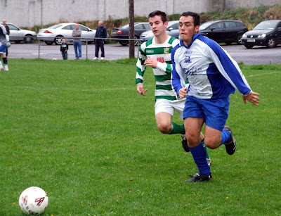John Kelly and Niall Murphy (Leeds) race for the ball