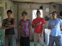 Guys and their mom in their home at O'ua