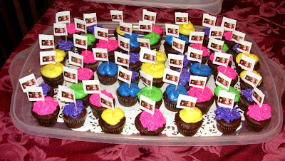 tray of cupcakes for the goodbye party, with address labels on toothpicks to make flags