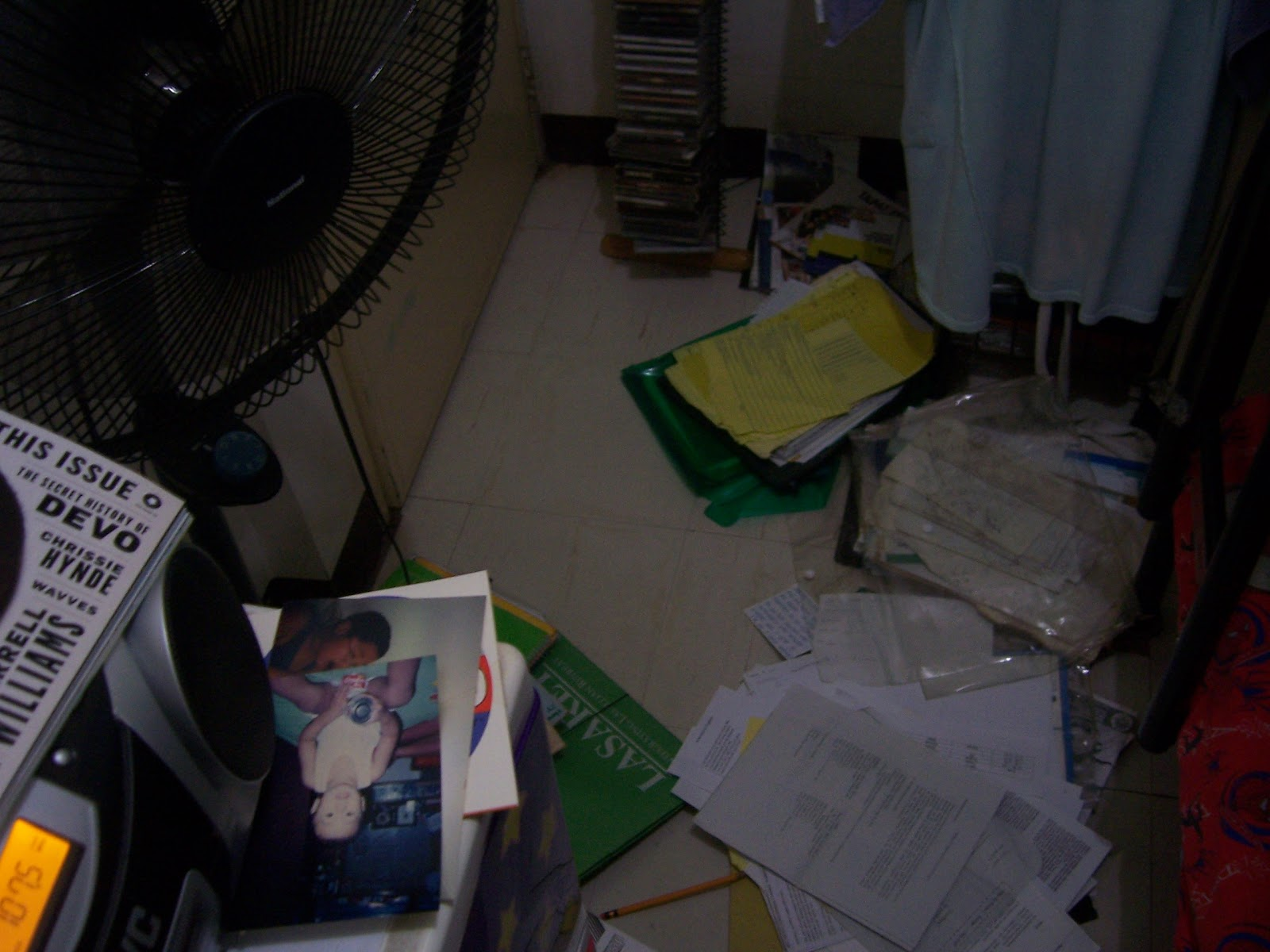 Friday night in my bedroom, with papers and whatnot from seven years of high school and college sorted out on the floor. And the electric fan, and the radio, and my sister's stuff.