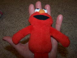 Elmo inside Holly's hand
