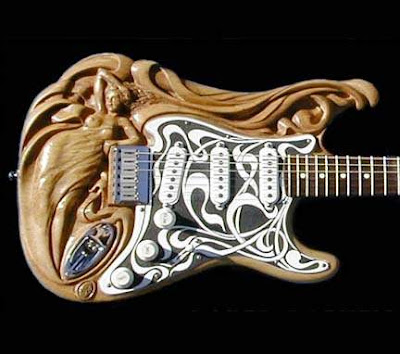 http://3.bp.blogspot.com/_TMlQo_69v-0/SAY2F7g794I/AAAAAAAAhoM/6Hfv3Z4Z1_Q/s400/guitar13.jpg