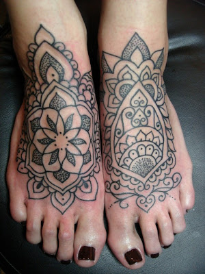 Comments: Feminine tattooed feet inspired by henna patterns.