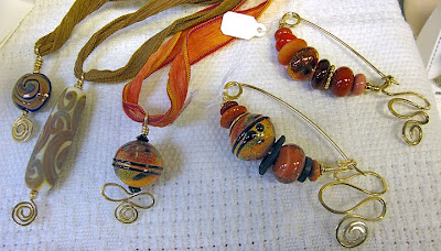 bead jewelry by Robin Atkins, fibula pins and pendants
