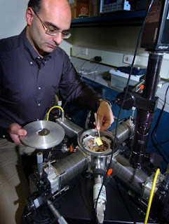 Caption: Dimitrios Peroulis, an assistant professor of electrical and computer engineering at Purdue, holds a new MEMS sensor at an
