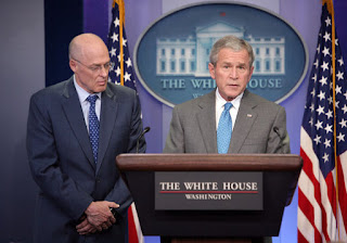 With Secretary of Treasury Hank Paulson looking on, President George W. Bush delivers a statement
