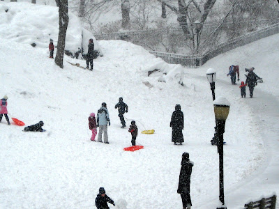 children snow sledding